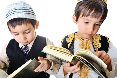 quran: Two kids reading holy Quran Stock Photo