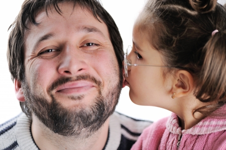 girls kissing: Little girl kissing her father