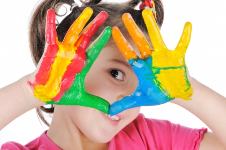 handprints: Smiling girl making triangle with her painted palms Stock Photo