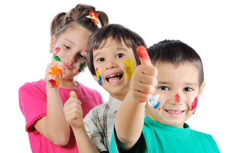 Messy children with paint on their hands and faces with thumbs up Stock Photo