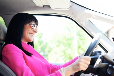 woman driving car: Business woman driving a car Stock Photo