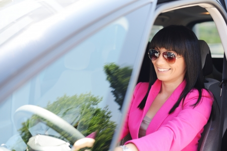 Business woman driving a car photo