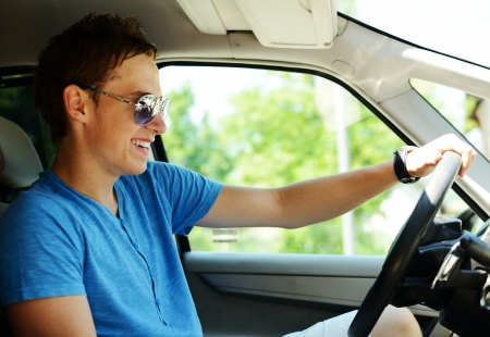 car driving: Young man driving a car Stock Photo