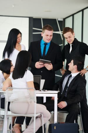 businessman talking: Business executives at a meeting discussing a work