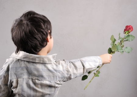 Boy giving a rose photo