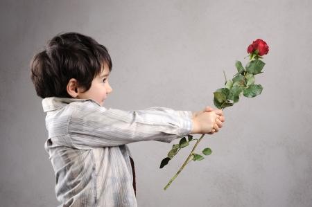 Boy giving a rose photo