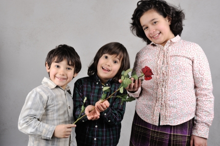 Beautiful kids with red rose photo