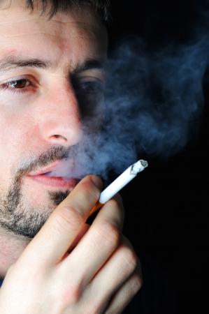 man smoking: Man smoking in dark