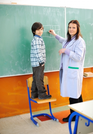 Kid and teacher in classroom photo