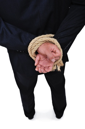Side view of businessman executive tied up with rope photo