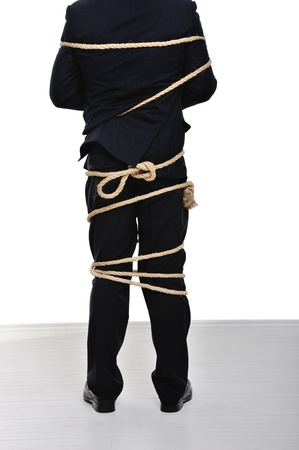 Businessman executive tied up with a rope photo