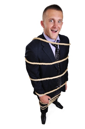 bound: Businessman tied up with a rope isolated over white background