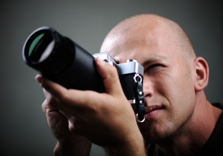 take action: Closeup of a photographer with camera