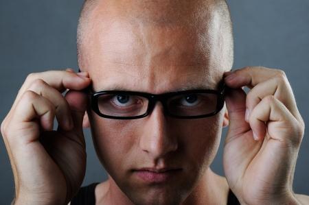 Young man wearing glasses studio portrait photo
