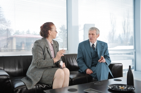 Two colleagues having a break during business meeting with cigarette Stock Photo - 19307128