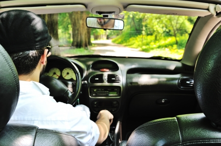 car safety: Potrait of a man driving a car without safety belt