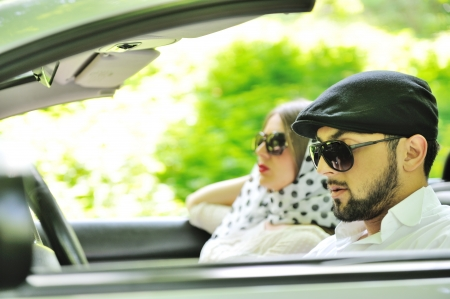 pace: Young couple enjoying in car at fast pace