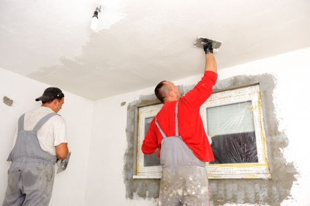 home renovation: Construction workers painting walls