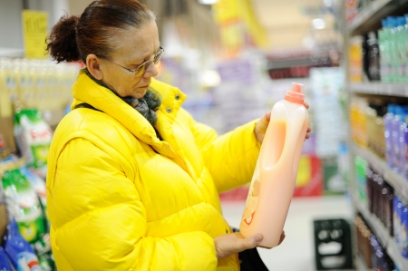 Elderly woman buying shampoo photo