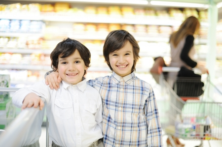 exhilarated: Two beautiful kids in shopping mall Stock Photo