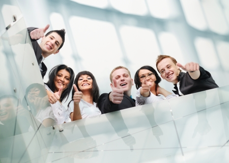 successful decisions: Group of business people at office with thumbs up Stock Photo
