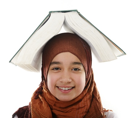 arab hijab: Female Arabic student balancing big book on head