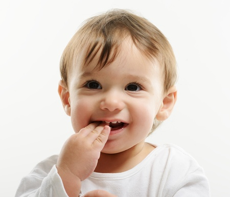 sweet tooth: Bright closeup portrait of adorable happy baby