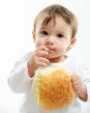 Baby eating bun bread photo