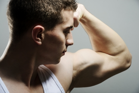 boy muscles: Teenager body builder shows biceps Stock Photo