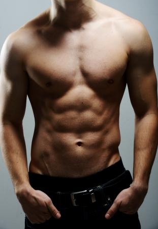 sexy jeans: Hombre musculoso sexy posando Foto de archivo