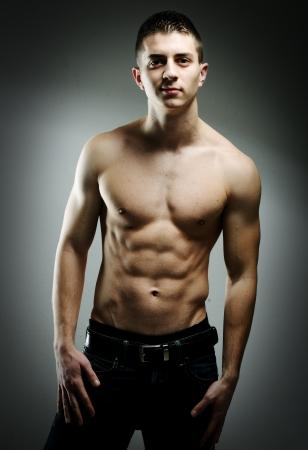 Young sexy muscular man posing photo