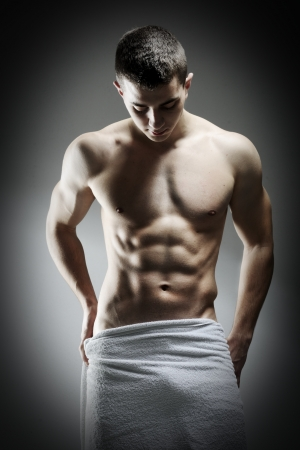 Young sexy muscular man posing photo