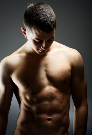 Young sexy muscular man posing Stock Photo - 19525742