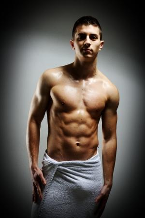 Young macho man using white towel Stock Photo - 19525748