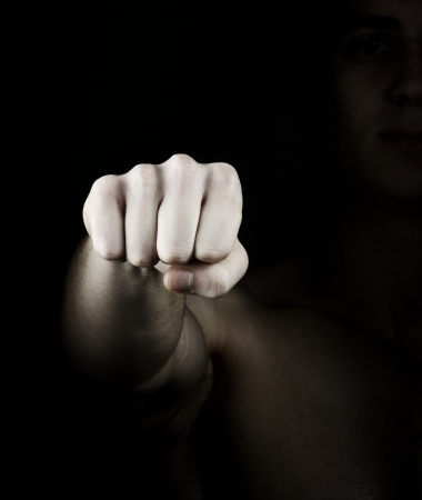 Fist on dark background photo