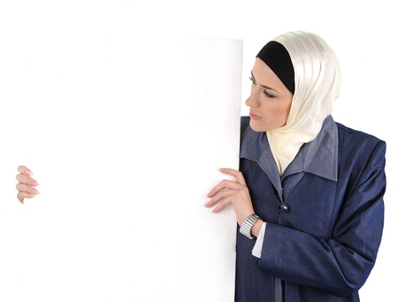 Arabic Muslim beautiful woman holding banner for your text photo