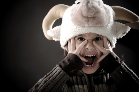 sheep eye: Portrait of authentic cute kid wearing funny sheep hat