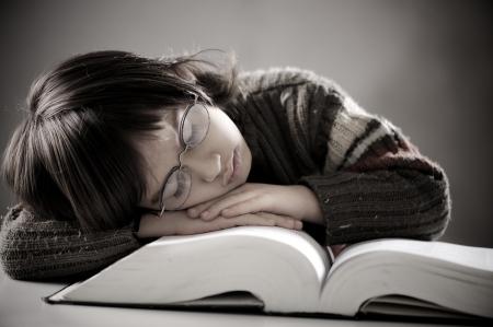 Fine portrait of cute little boy reading book photo