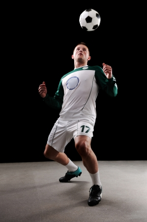 Soccer player over black background photo