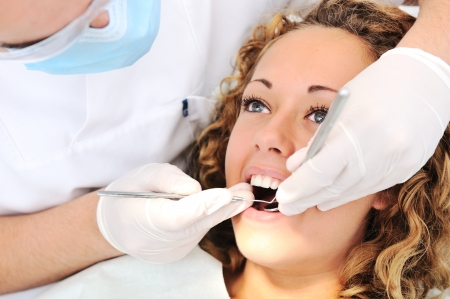 Healthy teeth patient at dentist office dental caries prevention photo