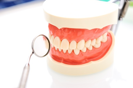 Dental mirror and teeth photo
