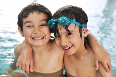 Cute little boy in swimming pool