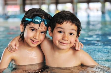 little boy swimming: Cute little boy in swimming pool