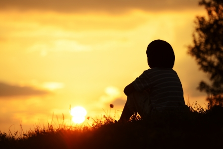 lonely person: Little boy spending happy time on summer nature