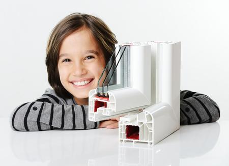 Kid holding plastic window profile Standard-Bild