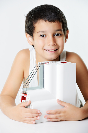 Kid holding plastic window profile Stock Photo - 26353763