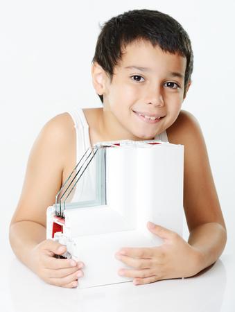 Kid holding plastic window profile Stock Photo - 26353764