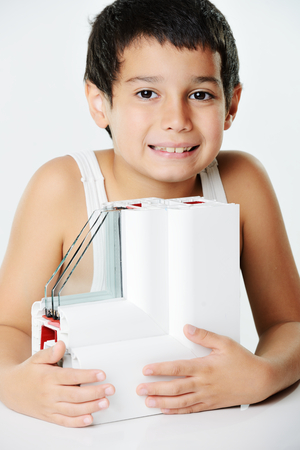 Kid holding plastic window profile Stock Photo - 26353765