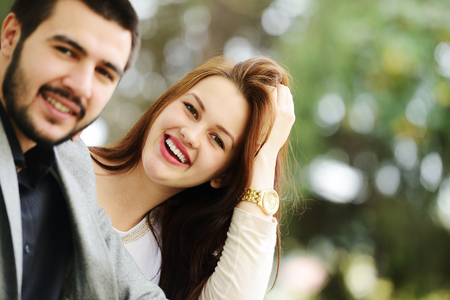 lovely couple: Lovely couple enjoying fall in love at park
