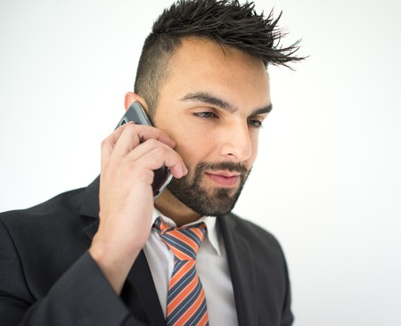 calling on phone: Portrait of attractive man calling on cell phone